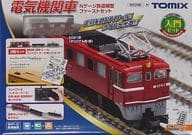 """Product Description セ ッ ト A set containing an electric locomotive and two wagons.  All the rails, power units, vehicles, etc. necessary to start TOMIX are now included.  The layout can be expanded using rails sold separately.   ■ About the electric locomotive -The body is red in the original color-Handrail, signal flame tube integrated license plate, maker's plate included  * Vehicle specification is  multi  Equivalent to the electric locomotive of the rail cleaning car set -The rail arrangement is a drop-in line and an evacuation line type   About the Tiger 70000 type wagon -The car number is printed """"74778""""  > ※ Vehicle specifications conform to  JNR Wagon Tiger 70,000   About Tam 500 type wagons -The car number is printed """"2503""""  * Vehicle specifications are  Same as Tom 500 type (silver)   ■ About rails -Adopt fine track rails, reproduce wood pillows, manual points   br About control equipment -Controller Sets compact power unit FG-17  In order to prevent derailment for beginners, suppress the highest speed    [Product Details]  Scale: 1/150 9mm (N gauge)  Motor: Yes  There is. Please be forewarned.  ※ Release date changed"""